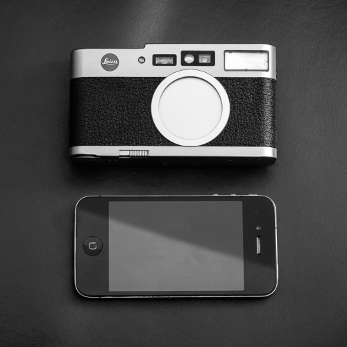 Leica CM size compared to the iphone 4.